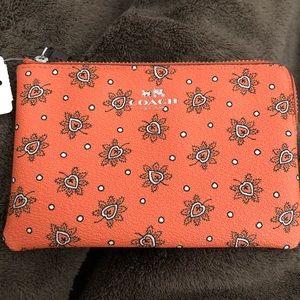 Coach Bags - NWT Coach gorgeous orange wristlet!!